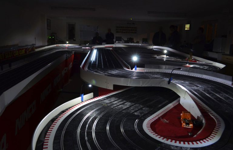 Molesey Scalextric Club Ninco track at night with floodlights